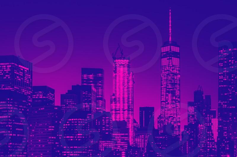 Night view of lower Manhattan skyline in New York. Blue and purple duotone effect photo