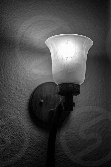 black and white wall sconce light warm glow alabaster glass wall light vintage light photo