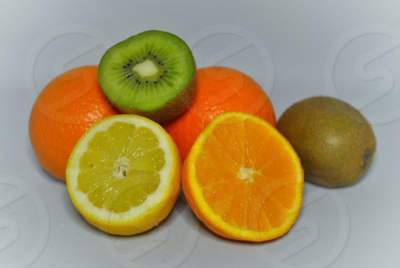 orange lemon fruit and kiwi fruit close up photography photo