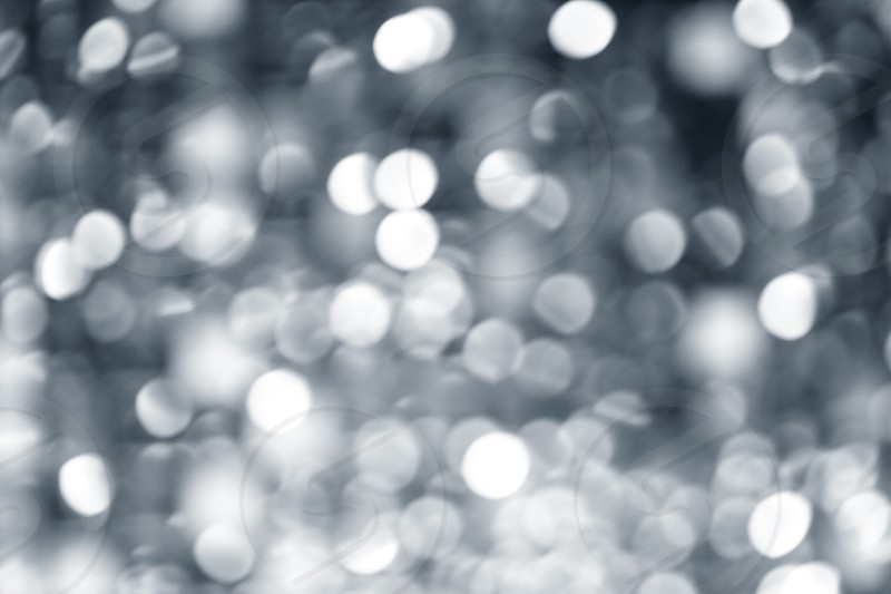 Abstract defocused blur silver christmas lights background photo