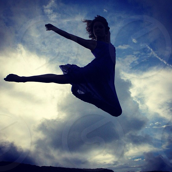 woman in blue tank top dress jumping photo