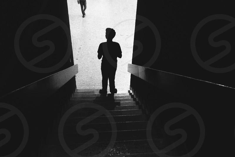 silhouette of boy near stairway photo