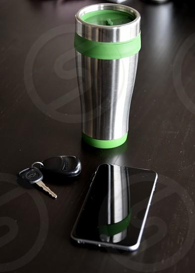 Morning coffee to go travel mug car keys phone smart phone table supplies busy photo