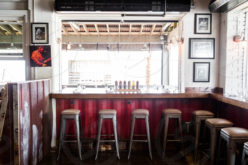 Wide open space with bar stools. photo