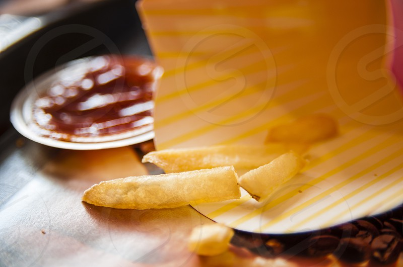 Closeup of leftover french fries on table photo