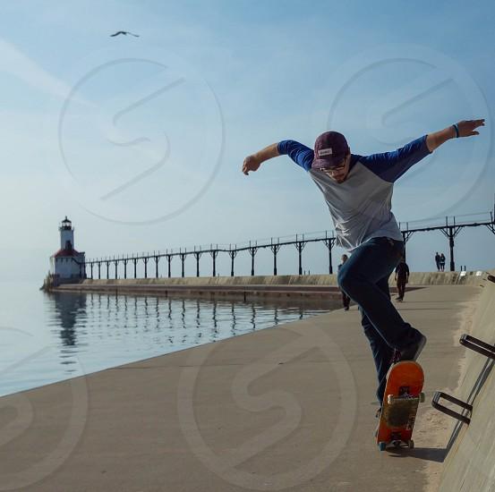 skateboard skateboarder lighthouse blue sports  photo