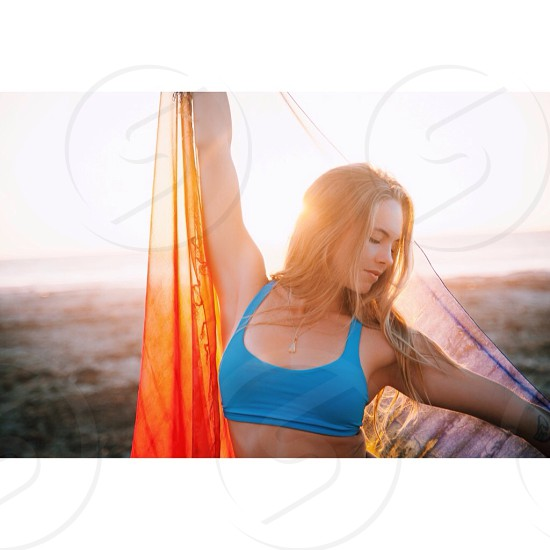 woman in blue sports bra with orange shawl photo