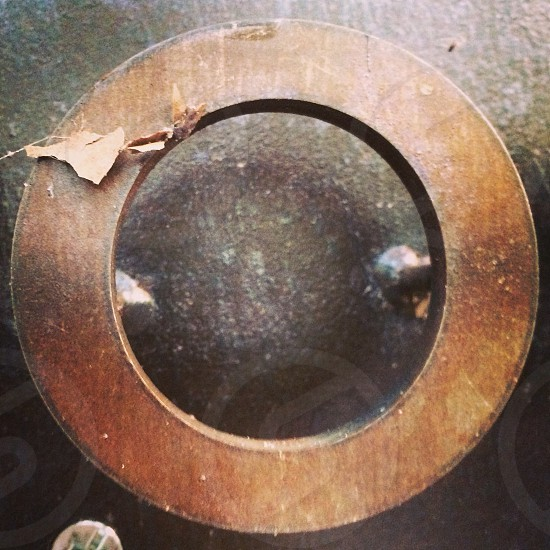 brown wooden round with hole in the center photo