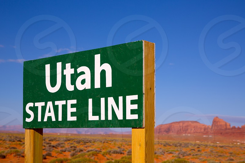 Road sign between Utah and Arizona State Line in Monument Valley photo