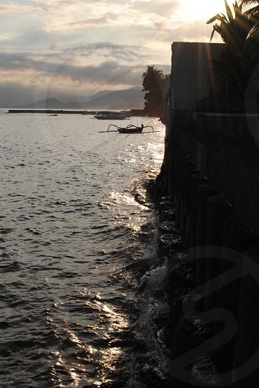 Coastline and boat (Candidasa - Bali) photo