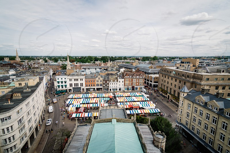High angle view of the city of Cambridge with colorful stalls market. photo