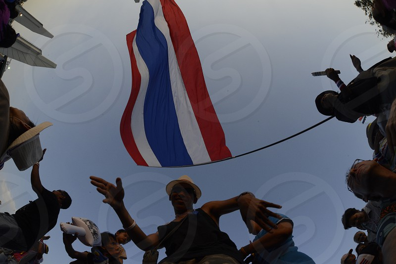 Thai anti-government protesters wave national flags during a rally at theDemocracy Monument in .Bangkok Thailand Saturday Jan.11  2014. photo