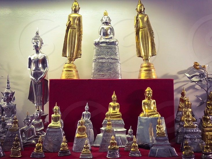 Buddha image statue monument relics Buddhist Buddhism temple gold golden religion monastery sacred pray worship homage sculpture art ancient antique artifact Thailand chiya museum display show old treasure heritage suratthani southeast Asia photo