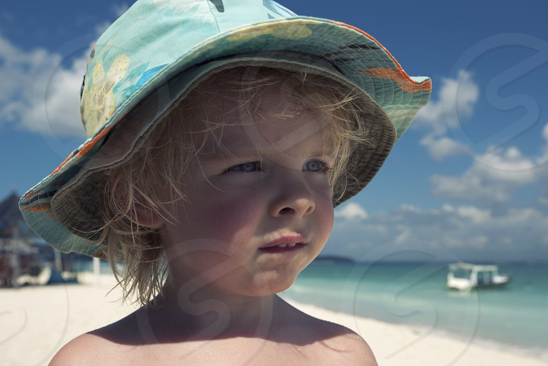 Toddler boy blonde Indonesia Bali nusa lembongan beach holiday travel sun summer hot. photo