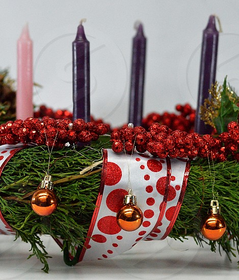 shallow focus photography of advent candle on wreath photo