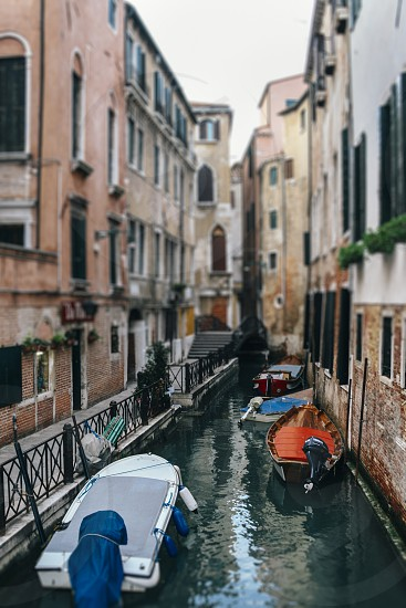 venice veneto italy canal canals boat boats water buildings selective focus blur tilt-shift photo