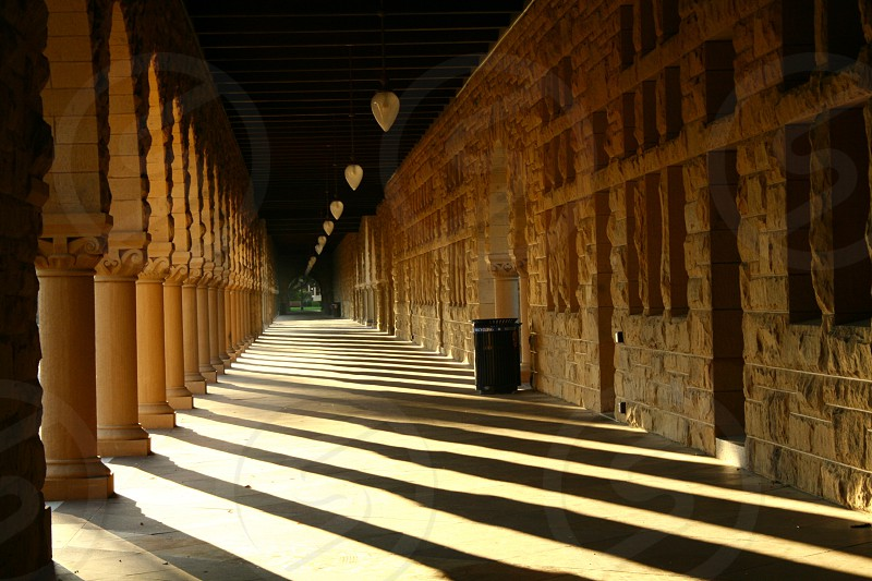 brown brick walled hallway photo