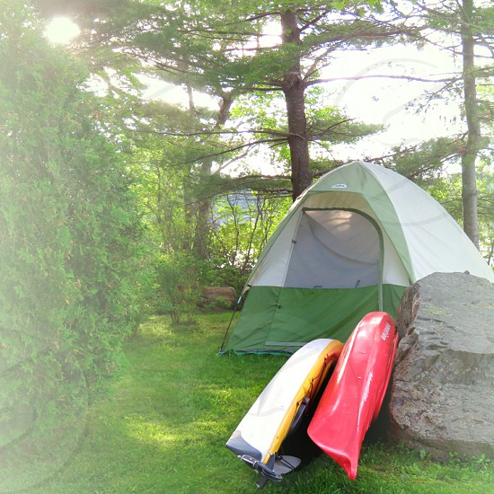 camping tenting summer two kayaks sunrise landscape  trees lake rock tent photo