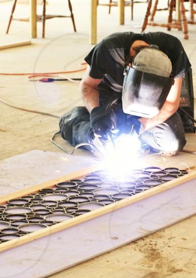 Welding metal work home improvement sparks torch circles photo