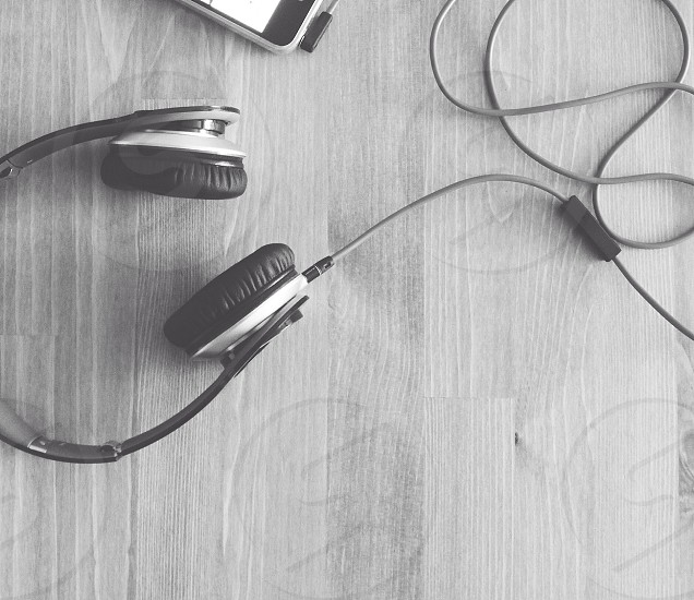 Natural lighting // black and white // headphones on a desk  photo