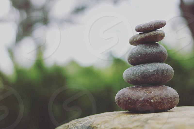 Balancing rocks nature differing shades calming. photo