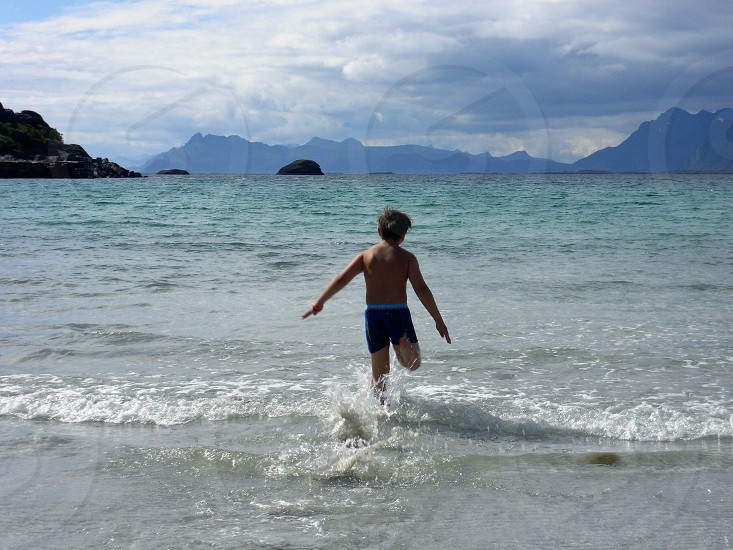 view of boy in seashore photo