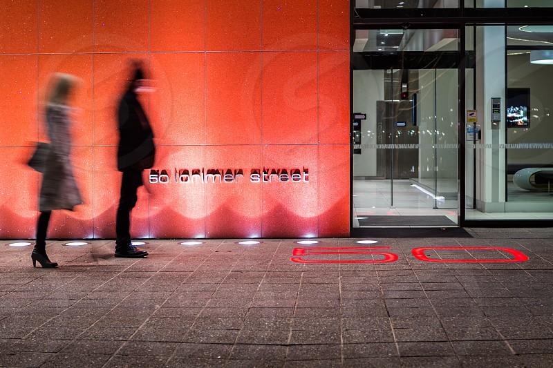 Street photography building lights red light Melbourne Victoria Australia night photography movement blur 50 people Ian Jones Photography pavement wall concrete photo