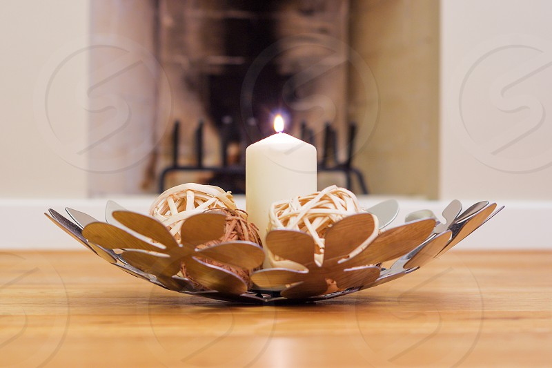 Decoration set with lit candle on the floor photo
