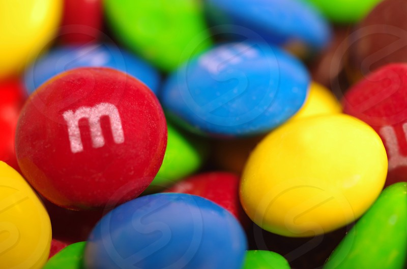 M&M Mars candy chocolate candies sweets colorful rainbow bites blue red brown yellow green tasty  photo