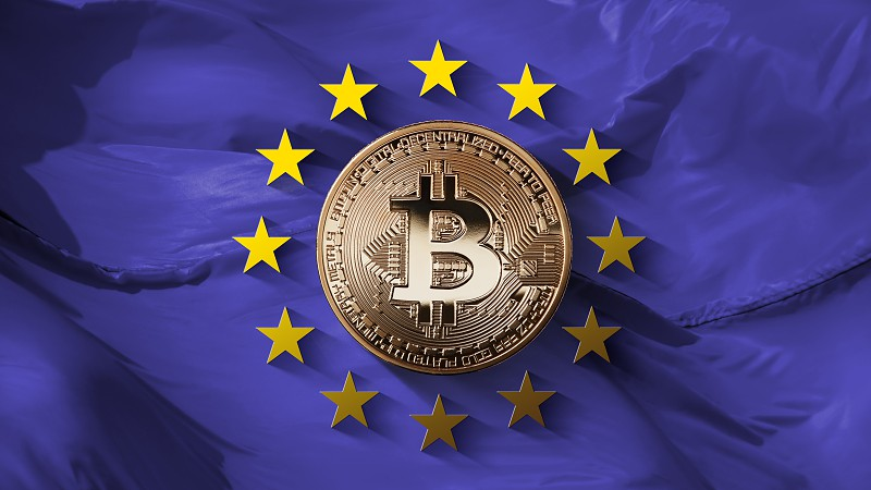 Stars of the European Union and bitcoin gold coin on an ultraviolet background. Control of the European Union bitcoin-platforms and the turnover of the crypto currency. Can be used for video or site cover photo