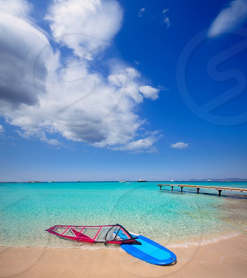 Formentera ibiza ses Illetes beach with windsurf on shore sand photo