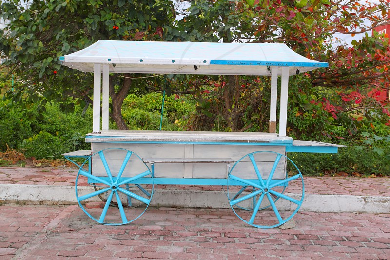 Ice cream hot dogs cart white blue in Caribbean island Isla Mujeres Mexico photo