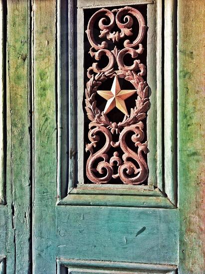 star designed gray wooden door photo
