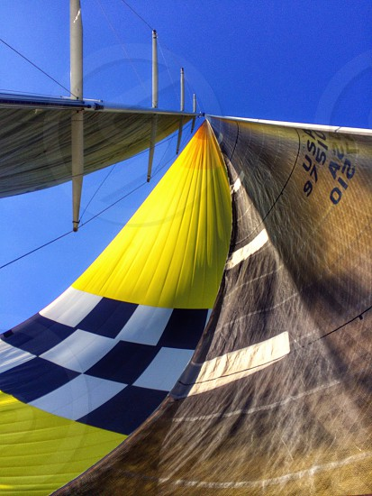 Looking up at the sails from under the deck of the sailboat. Sailing sails Pacific Ocean yacht sailboat regatta photo