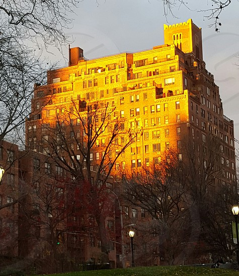 new York building aglow by central park photo