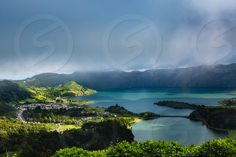 Sete Cidades. Blue and green lake in the volcano craters of the island of Sao Miguel part of the Azores.Blue and green lake in the volcano craters of the island of Sao Miguel part of the Azores photo