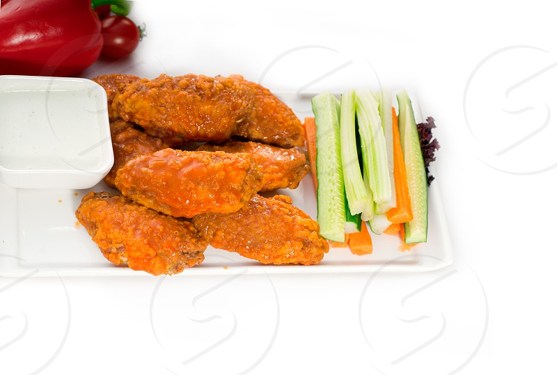 classic  buffalo chicken wings served with fresh pinzimonio and vegetables on backgroundMORE DELICIOUS FOOD ON PORTFOLIO photo