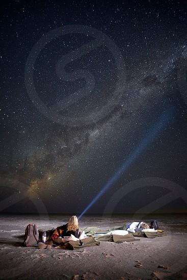 Night stars Galaxy camping botswana Ntwetwe salt pan bed sleeping torch woman beam light africa adventure travel photo