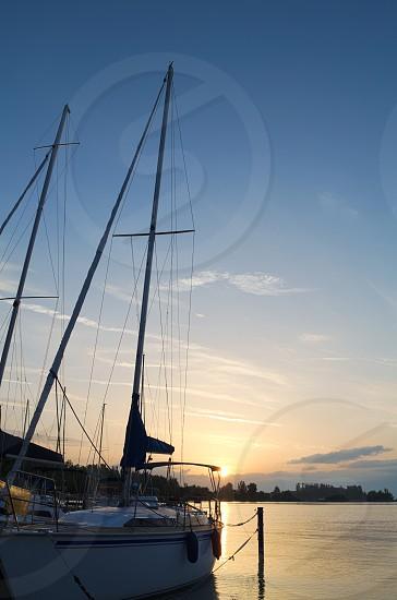 Sailboat on Lake Balaton at Dawn with Blue Sky photo