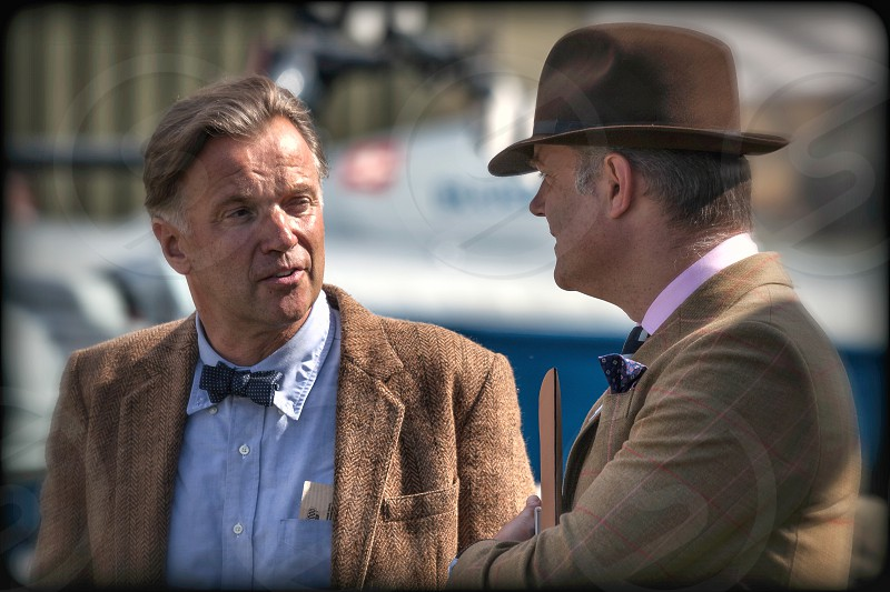 Two men deep in conversation at the Goodwood Revival photo