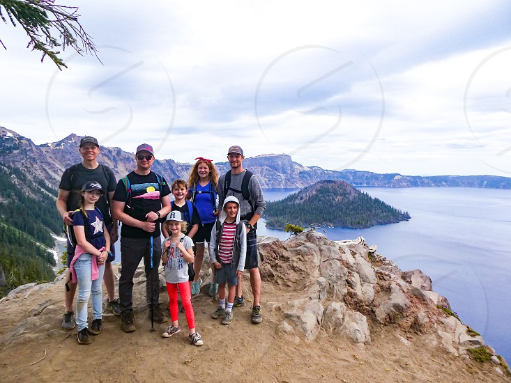 Hiking around the rim of Crater Lake - family portrait. photo