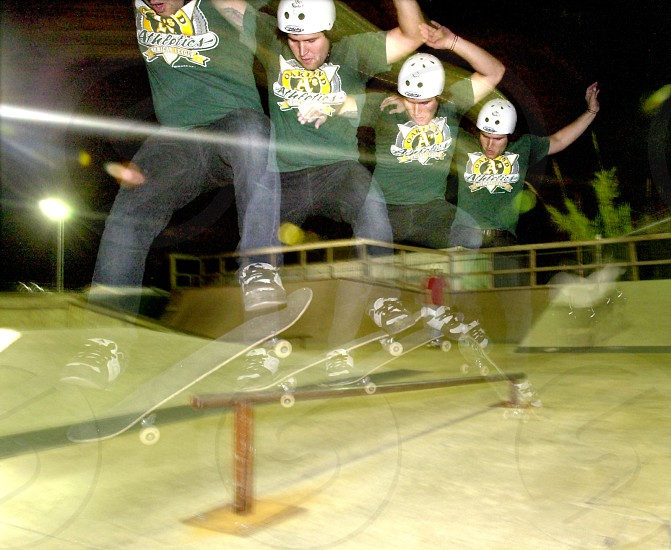 man making a skateboard stunt photo