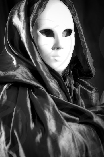 Black and white portrait of a man whit a Venetian carnival mask photo