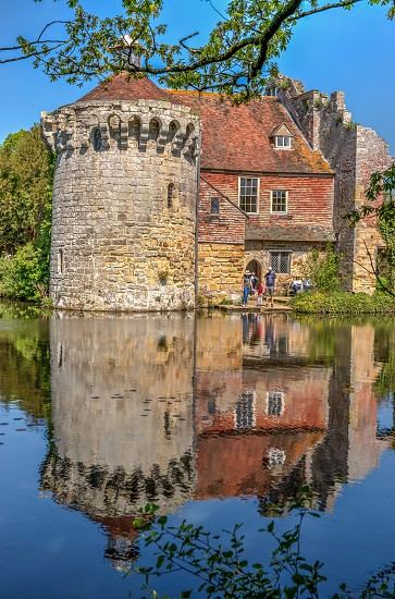 Scotney Castle and moat reflection High Dynamic Range image photo