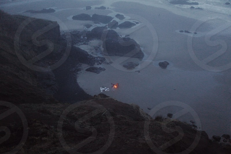 aerial view of rocky mountain and beach shore photo