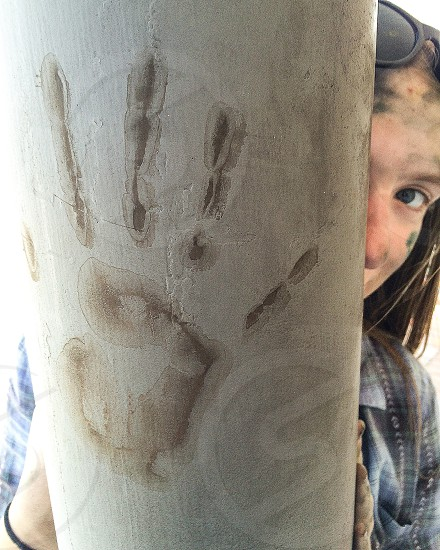 Girl mysterious hand print hand pillar creepy interesting  photo