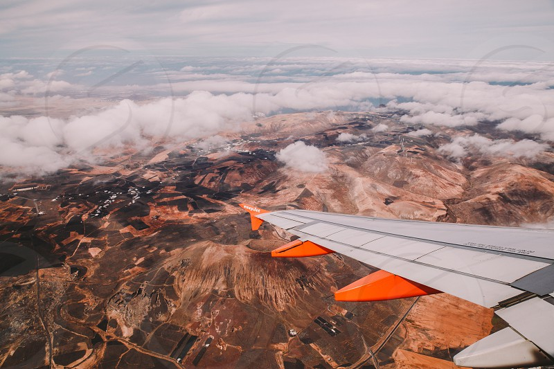 lanzarote aerial plane wing clouds photo