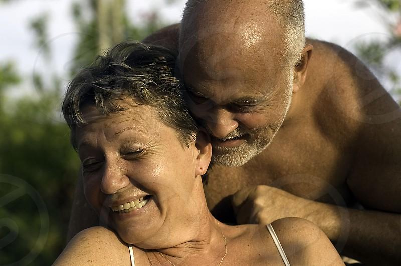 Elderly couple in lovingly happy embrace photo