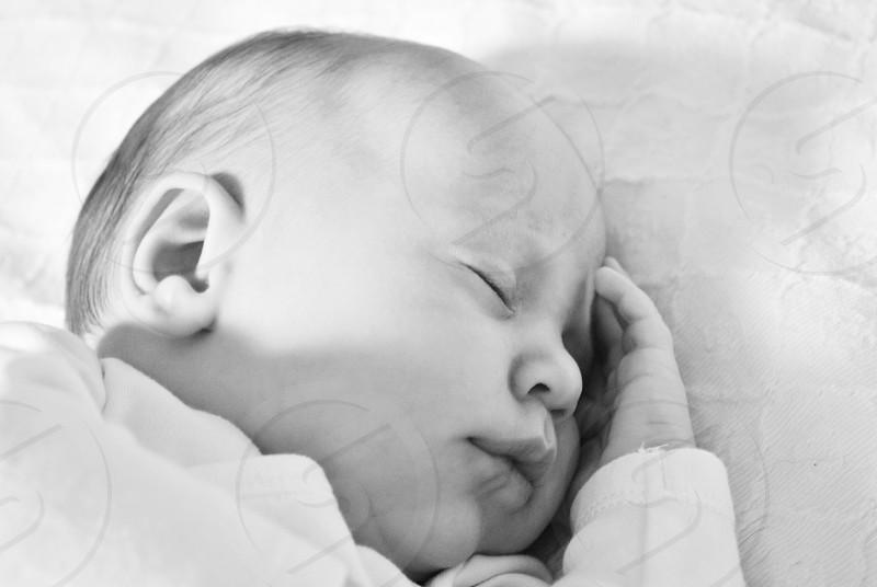 baby sleeping on bed photo