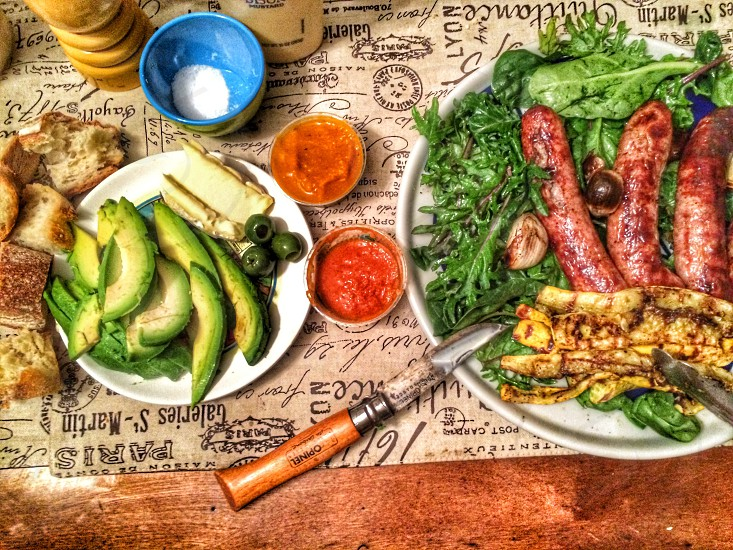 brown sausage with leaves on plate photo